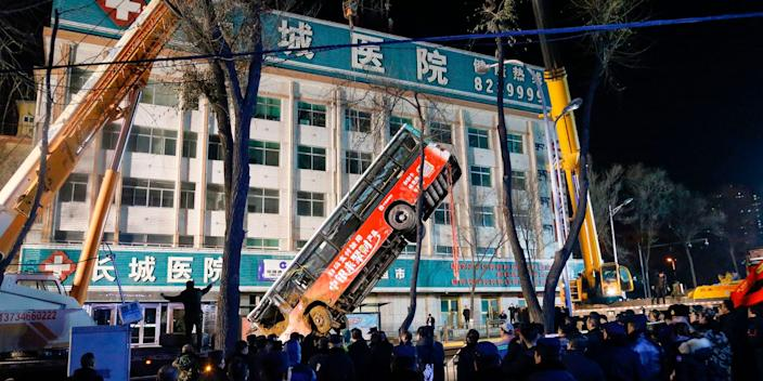 Bus being lifted out of the ground China sinkhole