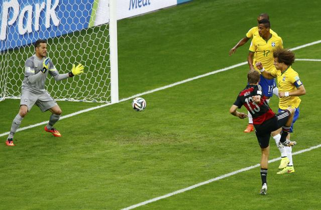 Germany's Thomas Mueller (13) scores against Brazil during their 2014 World Cup semi-finals at the Mineirao stadium in Belo Horizonte July 8, 2014. REUTERS/Leonhard Foeger (BRAZIL - Tags: SOCCER SPORT WORLD CUP TPX IMAGES OF THE DAY)