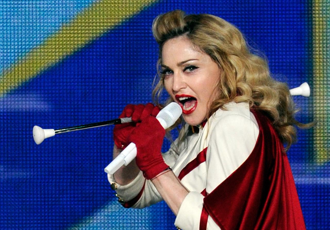 "Madonna performs at the MGM Grand Garden Arena as she tours in support of her album, ""MDNA"" October 13, 2012 in Las Vegas, Nevada.  (Photo by David Becker/Getty Images)"