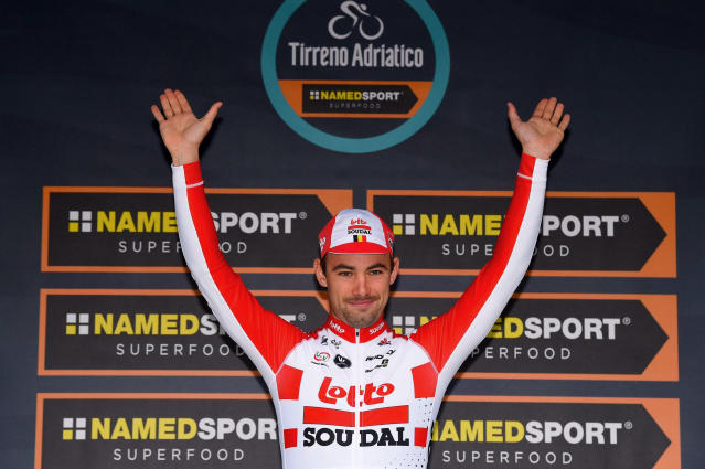 Belgian rider Victor Campenaerts celebrates on the podium after winning the seventh stage of the 54th Tirreno Adriatico cycling race, in San Benedetto del Tronto, central Italy, Tuesday, March 19, 2019. (Dario Belinghieri/ANSA via AP)