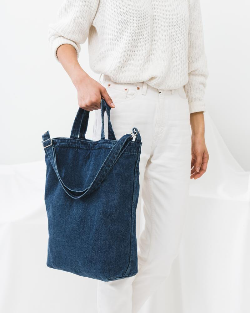 """<p>baggu.com</p><p><strong>$44.00</strong></p><p><a href=""""https://go.redirectingat.com?id=74968X1596630&url=https%3A%2F%2Fbaggu.com%2Fcollections%2Ftotes%2Fproducts%2Fduck-bag-dark-denim-l&sref=https%3A%2F%2Fwww.thepioneerwoman.com%2Ffashion-style%2Fg35005568%2Fcute-tote-bags%2F"""" rel=""""nofollow noopener"""" target=""""_blank"""" data-ylk=""""slk:Shop Now"""" class=""""link rapid-noclick-resp"""">Shop Now</a></p><p>Denim goes with everything, so why not go all out with a sturdy denim tote bag? This one has both short and long handles so it's easy to carry no matter how many things you have in your hands.</p>"""