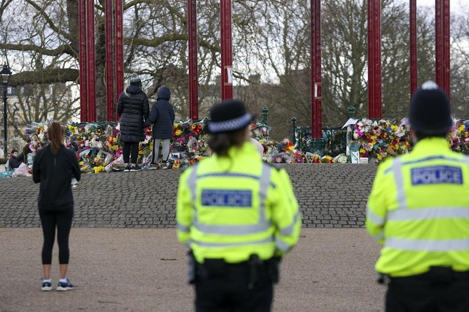 Police presence at a memorial to Sarah Everard (PA) (PA Archive)