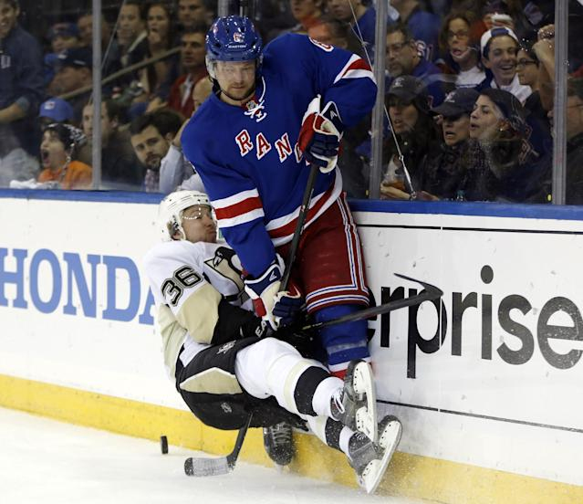 New York Rangers defenseman Anton Stralman (6), of Sweden, checks Pittsburgh Penguins left wing Jussi Jokinen (36), of Finland, in the first period of Game 6 of a second-round NHL playoff hockey series on Sunday, May 11, 2014, in New York. (AP Photo/Kathy Willens)