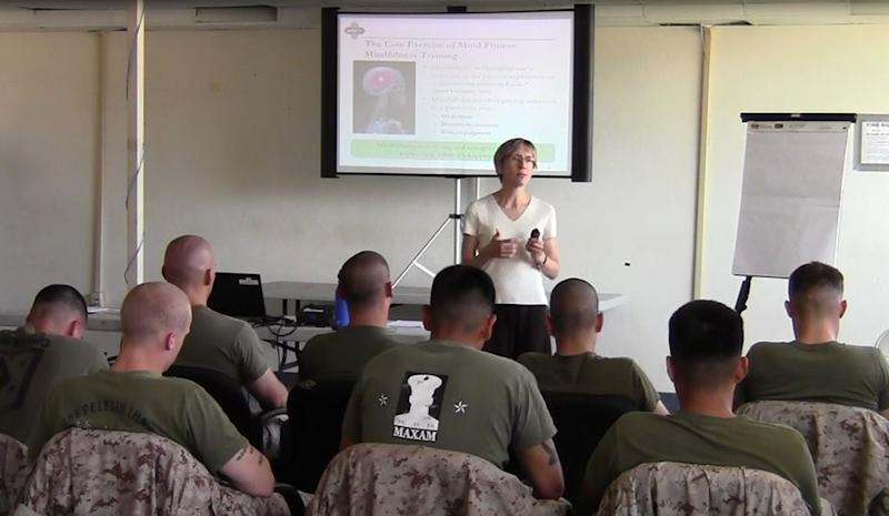 This 2011 image provided by Robert Skidmore shows Dr. Elizabeth Stanley, instructing a class of U.S. Marines at Camp Pendleton, Calif. The class was part of an experiment in 2011 in which 160 Camp Pendleton Marines learned to sit and stand during periods of silence and focus their attention on their bodies, breathing and the present moment so their mind could turn down the ongoing chatter about the past and future. (AP Photo/Robert Skidmore)