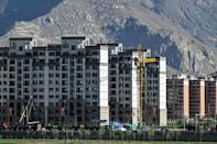 Alongside new construction is a plan to reduce the population living in the narrow, winding streets of historic central Lhasa, in the name of modernisation