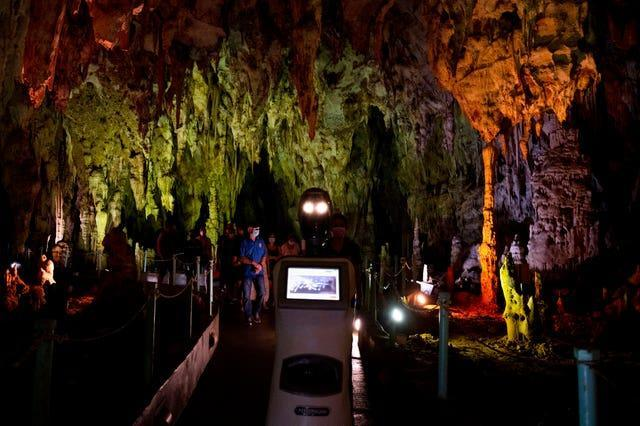Persephone guides the visitors inside Alistrati cave, north-east of Thessaloniki, Greece