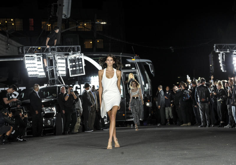 FILE - In this Sept. 9, 2017 file photo, Kaia Gerber models the first look at the Alexander Wang Spring 2018 fashion show held on a street in the Bushwick neighborhood of Brooklyn during New York Fashion Week. Supermodel Cindy Crawford says she understands it's inevitable that her daughter Kaia, 16, would enter the modeling world. Gerber bears a striking resemblance to her 51-year-old mother. (AP Photo/Diane Bondareff, File)
