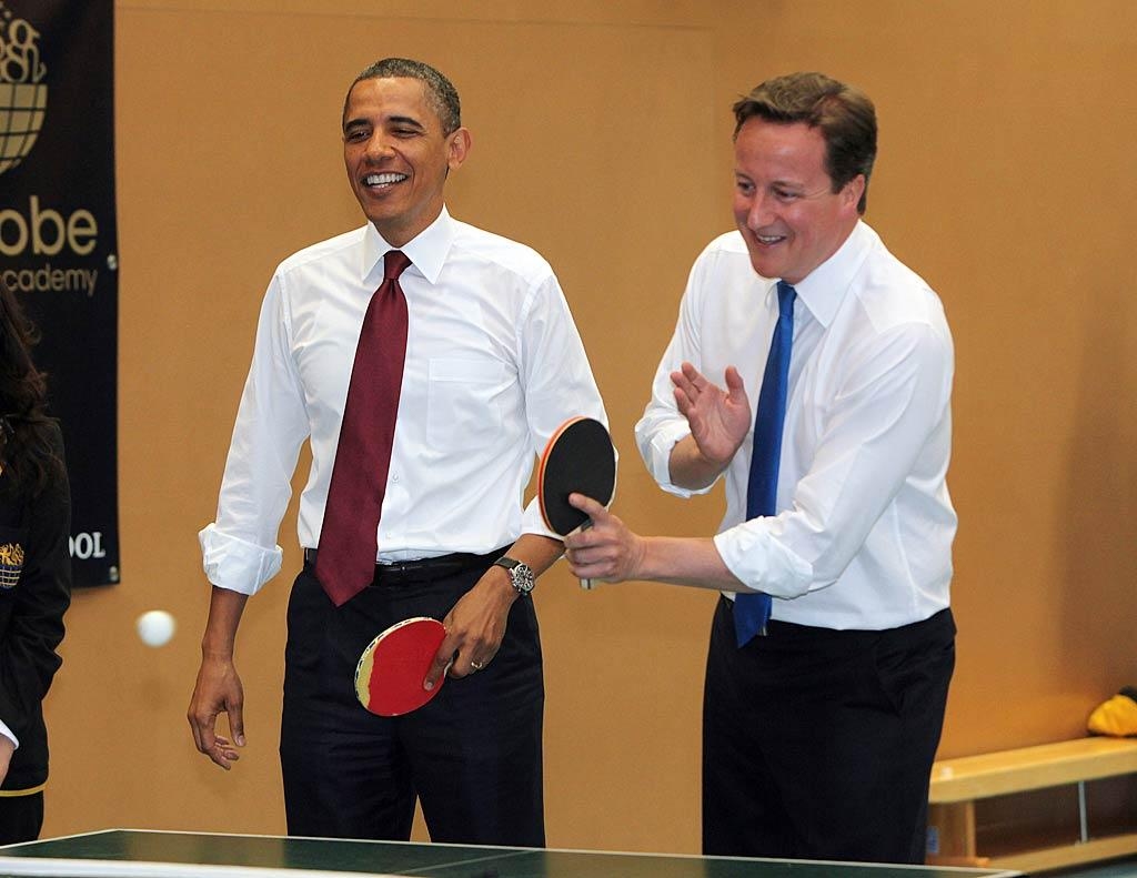 """President Obama had plenty of important stuff to do during his official visit to England this week, but why not start with a game of ping pong? He teamed up with British Prime Minister David Cameron to take on a couple of kids at Globe Academy school in London on Wednesday. Wonder if he asked Queen Elizabeth first ... WPA Pool/<a href=""""http://www.gettyimages.com/"""" target=""""new"""">GettyImages.com</a> - May 25, 2011"""