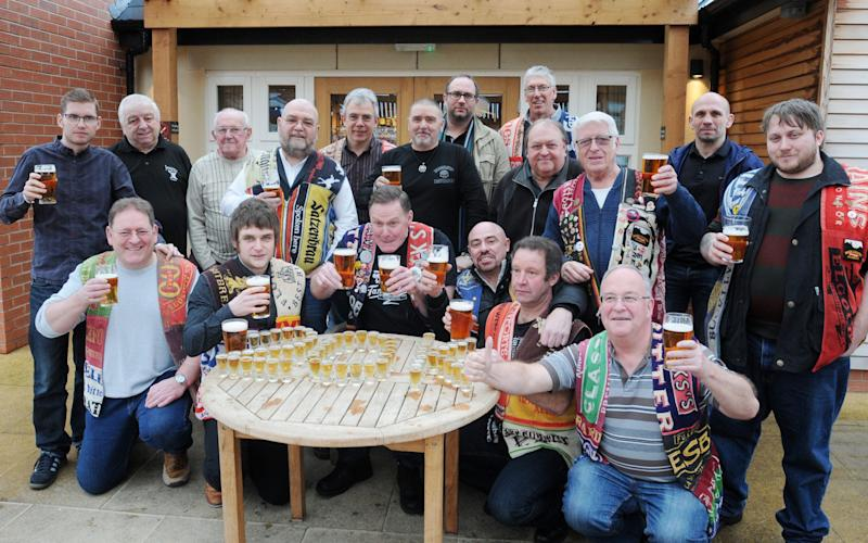 The Black Country Ale Tairsters celebrate visiting their 20,000th pub, the Knot and Plough in Stafford. - Credit: Matthew Cooper /PA