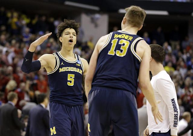 Michigan will get one of its two promising big men back next season. (AP)