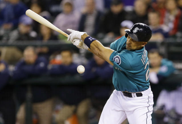 Seattle Mariners' Raul Ibanez fouls off a ball in the sixth inning of a baseball game against the Oakland Athletics, Friday, Sept. 27, 2013, in Seattle. (AP Photo/Ted S. Warren)