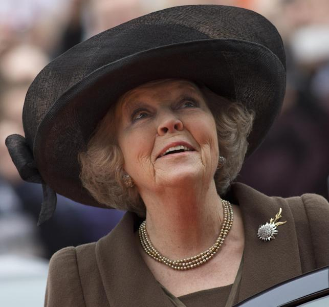 Netherlands' Queen Beatrix admires the renovated Rijksmuseum as she arrives for the official opening in Amsterdam, Saturday April 13, 2013. The Rijksmuseum, home to Rembrandt's Night Watch and other national treasures reopens its doors to the public after a decade-long renovation. On the first day, Saturday April 13, admissions are free and the museum stays open till midnight. Queen Beatrix has announced she will relinquish the crown on April 30, 2013, after 33 years of reign, leaving the monarchy to her son Crown Prince Willem Alexander. (AP Photo/Peter Dejong)