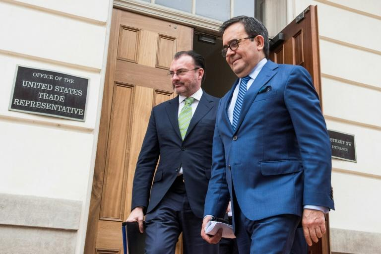 Mexico's Foreign Minister  Luis Videgaray (L) and Economy chief Ildefonso Guajardo, as they leave talks in Washington to update NAFTA on August 22, 2018