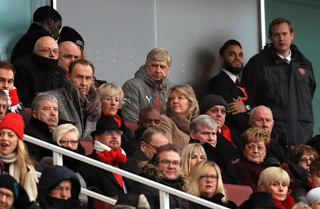 <p>Arsenal manager Arsene Wenger watches the action from the stands </p>