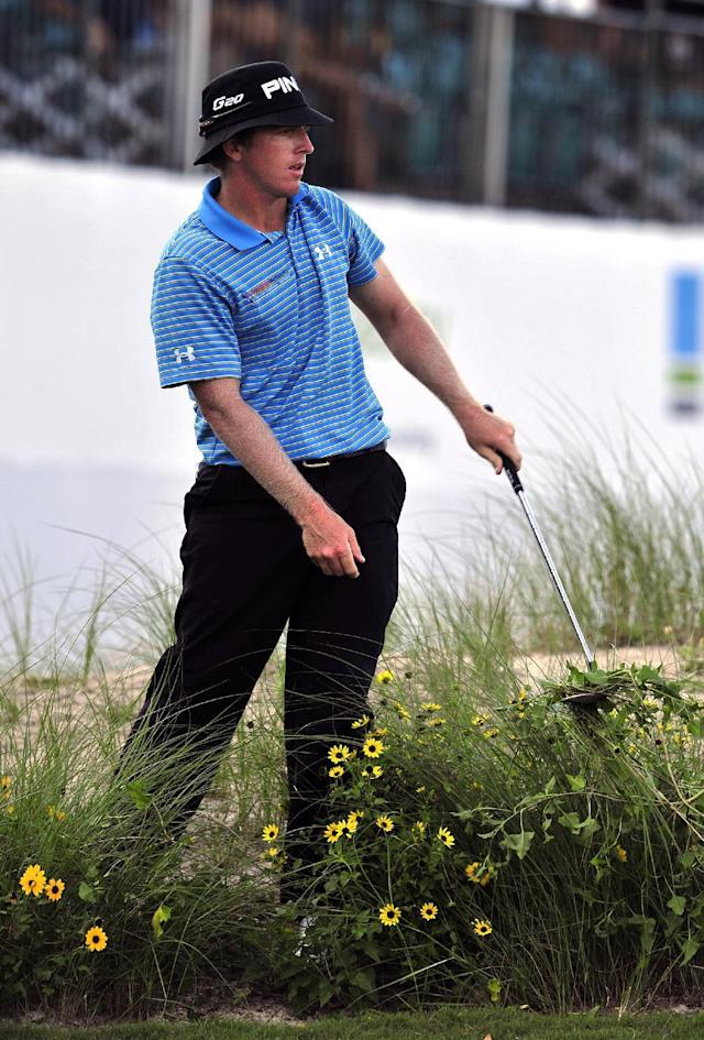 Martin Piller hits out of the rough on the 18th green for a bogey during the first round of the McGladrey Classic golf tournament at the Sea Island Golf Club on St. Simons Island, Ga., Thursday, Oct. 13, 2011. (AP Photo/Stephen Morton)