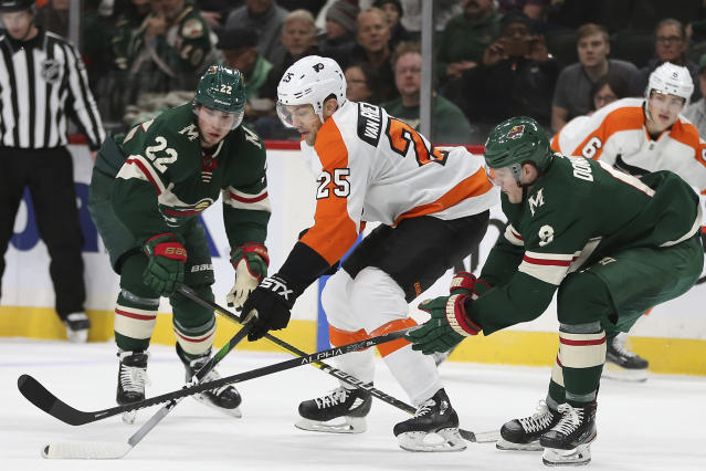 RETRANSMISSION TO CORRECT ID TO KEVIN FIALA - Philadelphia Flyers' James van Riemsdyk goes after the puck against Minnesota Wild's Kevin Fiala (22) and Ryan Donato, right, in the second period of an NHL hockey game Saturday Dec. 14, 2019, in St. Paul, Minn. (AP Photo/Stacy Bengs)