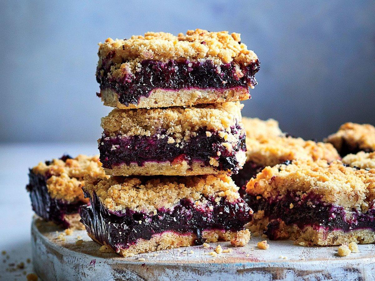 "<p>Consider yourself warned: A crunch may look like a <a href=""https://www.southernliving.com/food/holidays-occasions/best-cookies-recipes"">bar cookie</a>, but you'll need a fork to eat it. Similar to a crisp with baked fruit and a crumbly topping, a crunch sandwiches a layer of <a href=""https://www.southernliving.com/food/holidays-occasions/fresh-summer-berry-cobblers-pies-tarts-ice-cream-recipes"">jammy fruit</a> between two buttery layers. While other fruit desserts are on the syrupy side, this fruit is cooked down into a flavor-packed, thick preserve. The bottom layer should be firm enough not to crumble when a piece is cut from the pan, so adding toasted pecans to the mix improves the taste as well as the texture. The top layer can duplicate the bottom, or it can be a simple streusel topping made with flour, sugar, and butter.</p> <p><a href=""https://www.myrecipes.com/recipe/blueberry-lemon-crunch-bars"">Blueberry-Lemon Crunch Bars Recipe</a></p>"