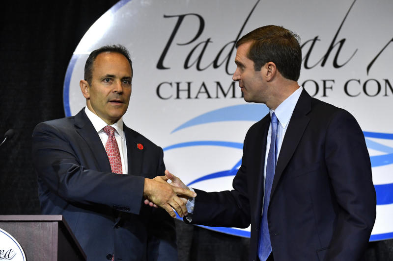 "FILE - In this Thursday, Oct. 3, 2019 file photo, Kentucky Governor and Republican candidate Matt Bevin, left, shakes hands with Attorney General and Democratic candidate Andy Beshear before the start of a gubernatorial debate in Paducah, Ky. Looking to pull the plug on one of Democrat Andy Beshear's campaign themes, two top Republican lawmakers said Thursday, Oct. 17, 2019 that any effort to legalize casino gambling would be ""dead on arrival"" in the Senate. (AP Photo/Timothy D. Easley, File)"