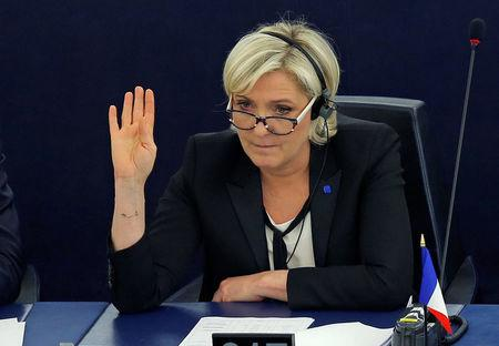 FILE PHOTO - Marine Le Pen, French National Front political party leader and MEP, takes part in a voting session at the European Parliament in Strasbourg