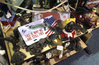 Items are for sale at Exit 76 Antique Mall in Edinburgh, Indiana, Tuesday, July 21, 2020. U.S. Rep. Greg Pence, the older brother of Vice President Mike Pence, is coming under criticism for allowing the sale of objects with racist depictions of African Americans at the sprawling antiques mall the congressman owns with his wife. (AP Photo/Casey Smith)