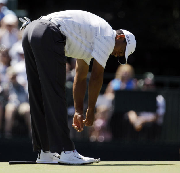 Tiger Woods reacts after missing a birdie putt on the 15th green during the third round of the Masters golf tournament Saturday, April 7, 2012, in Augusta, Ga. (AP Photo/Charlie Riedel)