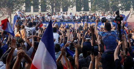 Soccer Football - World Cup - France Victory Parade on the Champs Elysees - Paris, France - July 16, 2018   France team bus and fans during the parade   REUTERS/Jean-Paul Pelissier