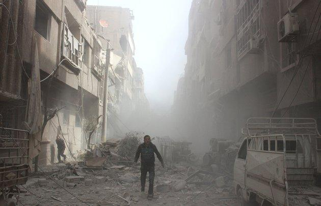 Buildings are damaged after airstrikes in eastern Ghouta, near Damascus, Syria, on Monday.