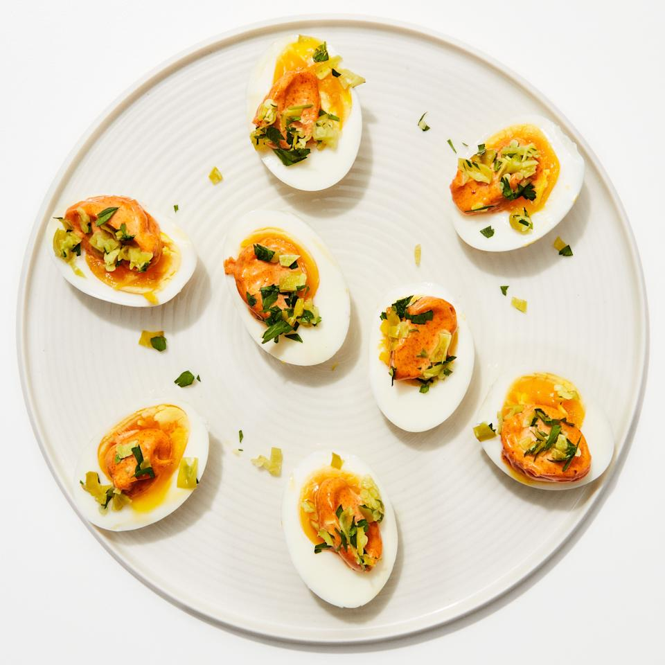 """Like deviled eggs—but faster, easier, more delicious, and fancier-sounding. This recipe calls for peperoncini, but most pickle-y things (cornichons, olives, that jar of dilly beans you've had for years) will work just as well. <a href=""""https://www.bonappetit.com/recipe/jammy-eggs-with-paprika-aioli?mbid=synd_yahoo_rss"""">See recipe.</a>"""