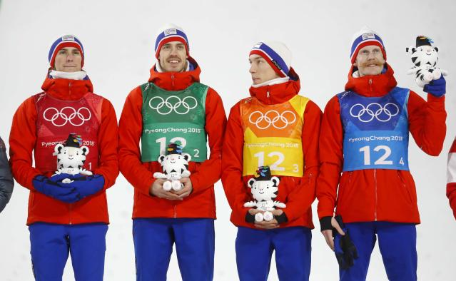 Ski Jumping - Pyeongchang 2018 Winter Olympics - Men's Team Final - Alpensia Ski Jumping Centre - Pyeongchang, South Korea - February 19, 2018 - Gold medalists Daniel Andre Tande, Andreas Stjernen, Johann Andre Forfang and Robert Johansson of Norway celebrate during the victory ceremony. REUTERS/Kai Pfaffenbach