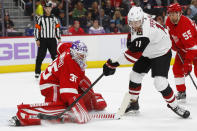 Detroit Red Wings goaltender Jimmy Howard (35) stops an Arizona Coyotes left wing Brendan Perlini (11) shot in the first period of an NHL hockey game Tuesday, Nov. 13, 2018, in Detroit. (AP Photo/Paul Sancya)
