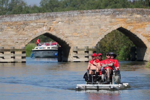 The team pedaled from Lechlade in Gloucestershire to Teddington in south-west London in just over two days (Jonathan Brady/PA)