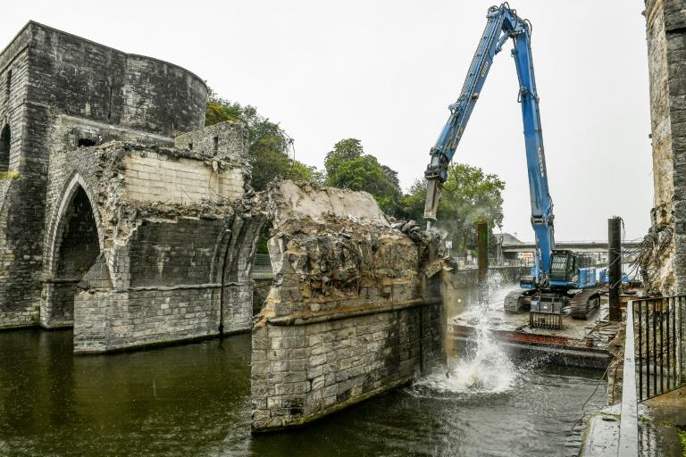 Workers pressed ahead with demolishing the arches which were rebuilt after World War II when British troops blew up the original medieval bridge over the Scheldt at Tournai (AFP Photo/Philippe HUGUEN)