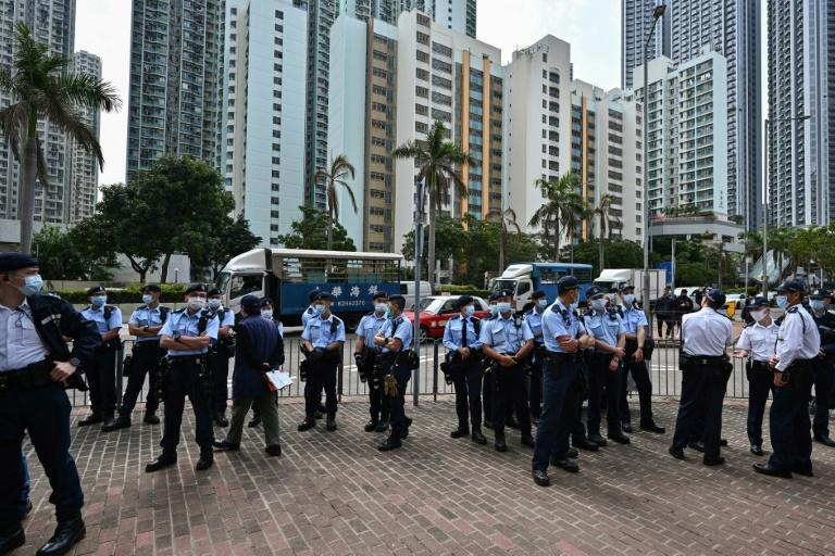 Large numbers of police stood guard outside the West Kowloon court in Hong Kong during court appearances by dozens of dissidents