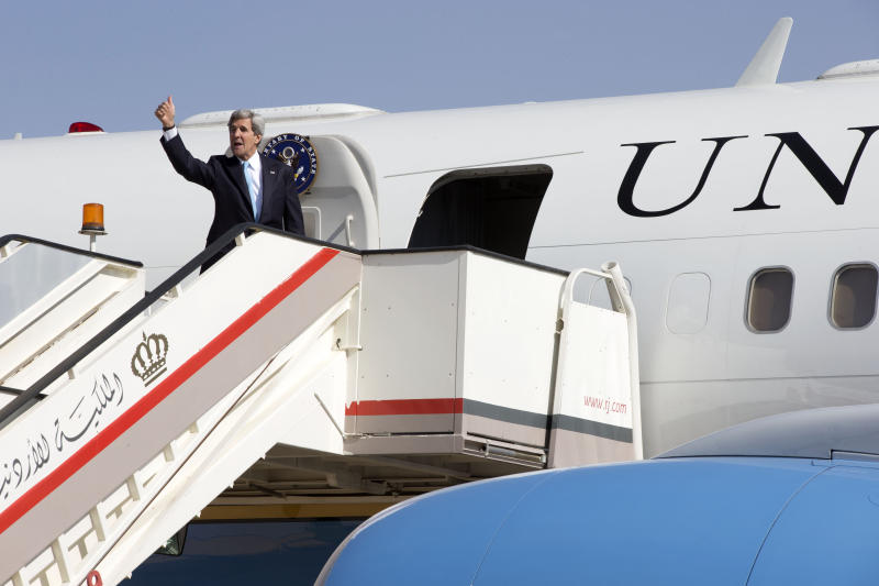 U.S. Secretary of State John Kerry boards his plane in Amman, Jordan, to return once again to Jerusalem for more talks in the hopes of renewing negotiations on an Israeli-Palestinian peace process on Saturday, June 29, 2013. (AP Photo/Jacquelyn Martin, Pool)