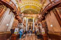 "<p>If you're searching for a book to get lost in, it only makes sense to channel your inner Matilda and head to the nearest <a href=""https://www.housebeautiful.com/lifestyle/g32258176/libraries-tour-virtually-prague-morgan-nypl/"" rel=""nofollow noopener"" target=""_blank"" data-ylk=""slk:library"" class=""link rapid-noclick-resp"">library</a>, and hopefully, you'll be left with a feeling of inspiration beyond what you read. At<em> House Beautiful, </em>we are partial to <a href=""https://www.housebeautiful.com/room-decorating/home-library-office/"" rel=""nofollow noopener"" target=""_blank"" data-ylk=""slk:libraries"" class=""link rapid-noclick-resp"">libraries</a> that also serve up a serious dose of design inspiration.—and lucky for us, there are many around the world. Whether it's the remarkable architecture of the Rampur Raza Library in India—which features a combination of Hindu, Victorian Gothic, and Islamic elements—or the heavenly ceiling of the Rose Main Reading Room at the New York Public Library, you might even forget that you're standing in a <a href=""https://www.housebeautiful.com/room-decorating/home-library-office/g696/designer-libraries/"" rel=""nofollow noopener"" target=""_blank"" data-ylk=""slk:library"" class=""link rapid-noclick-resp"">library</a> and not a palace. After all, the right books will transport you to places as awe-inspiring as these libraries, no matter your location. </p>"