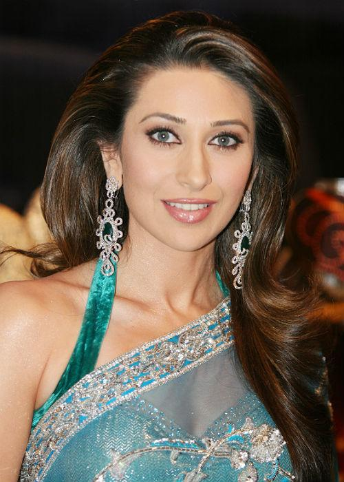 <b>3.	Karishma Kapoor: </b>Kareena's big sister took elegance to a whole new level by teaming this sheer blue saree with a sexy halter blouse. We must agree motherhood has not wiped off her style sense.