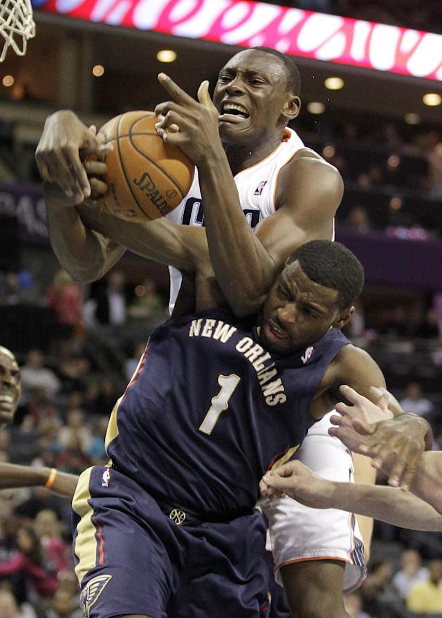Charlotte Bobcats' Bismack Biyombo gets on top of New Orleans Pelicans' Tyreke Evans for a rebound during the first half of an NBA basketball game in Charlotte, N.C., Friday, Feb. 21, 2014. (AP Photo/Bob Leverone)