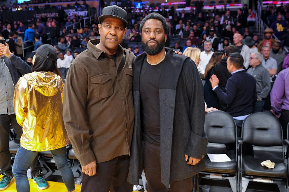 LOS ANGELES, CALIFORNIA - DECEMBER 05: Actors Denzel Washington and son John David Washington attend a basketball game between the Los Angeles Lakers and the San Antonio Spurs at Staples Center on December 05, 2018 in Los Angeles, California. (Photo by Allen Berezovsky/Getty Images)