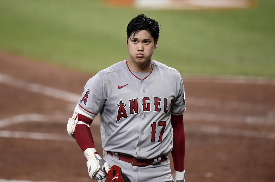 BALTIMORE, MARYLAND - AUGUST 25: Shohei Ohtani #17 of the Los Angeles Angels walks to the dugout after striking out in the sixth inning against the Baltimore Orioles at Oriole Park at Camden Yards on August 25, 2021 in Baltimore, Maryland. (Photo by G Fiume/Getty Images)