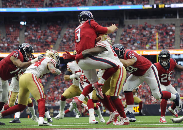Texans quarterback Tom Savage (3) is hit by San Francisco 49ers defensive end Elvis Dumervil after throwing a pass. (AP)