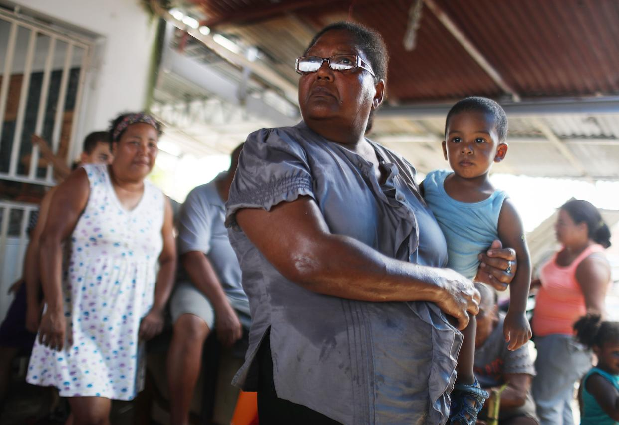 Americans in San Isidro, Puerto Rico, wait for FEMA to arrive with water. Their neighborhood has been without power or clean water for more than a month. (Photo: Mario Tama via Getty Images)