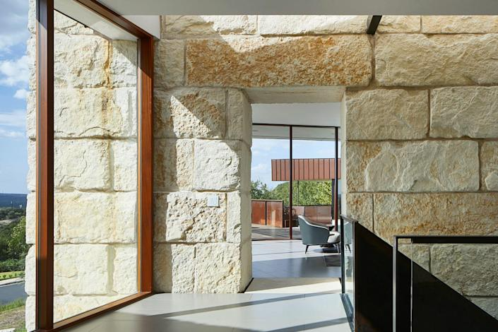 The Texas house by BERCY CHEN STUDIO uses local limestone instead of concrete.