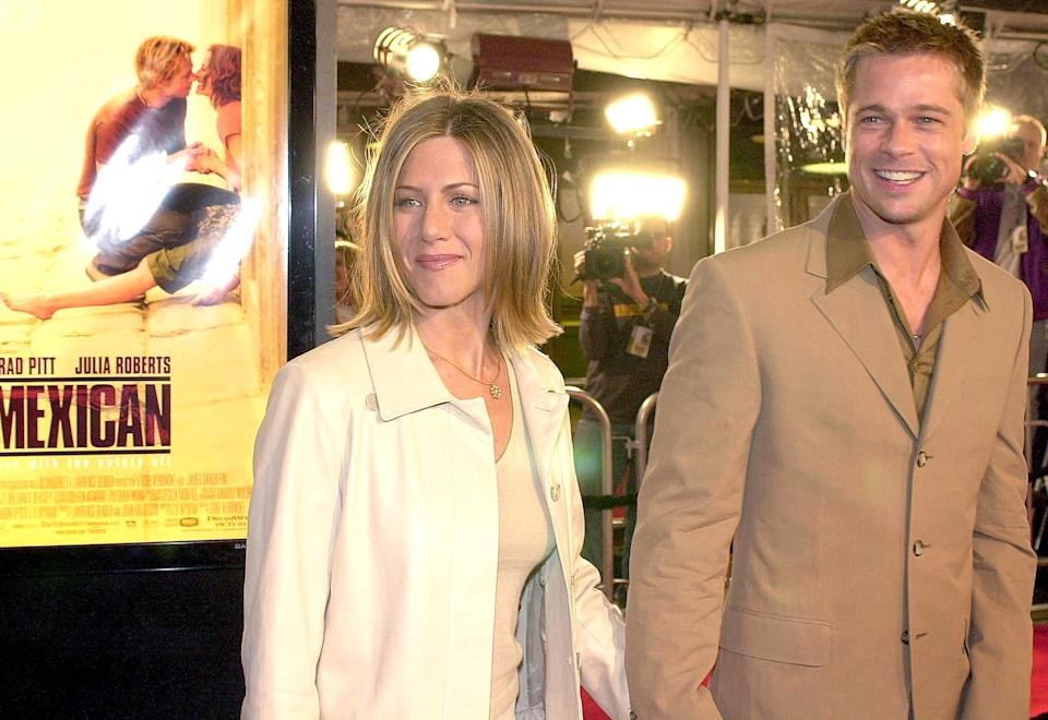 US actor Brad Pitt (R) arrives at the premiere of his new film
