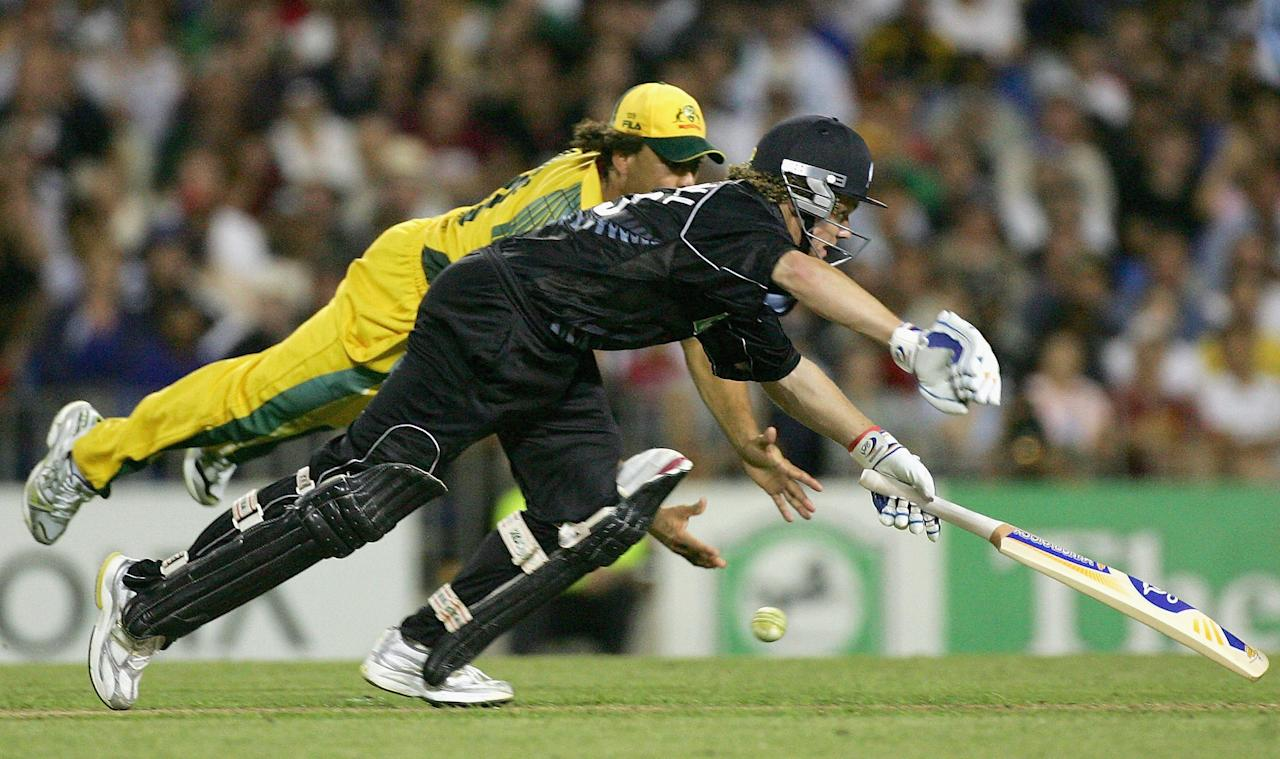 AUCKLAND, NEW ZEALAND - FEBRUARY 26:  Andrew Symonds of Australia dives to run out James Marshall of New Zealand during the 3rd One Day International between New Zealand and Australia played at Eden Park on February 26, 2005 in Auckland, New Zealand  (Photo by Hamish Blair/Getty Images)
