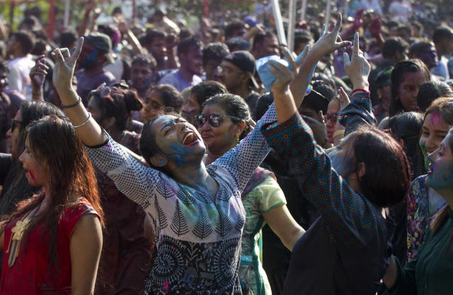 In this Wednesday, March 20, 2019, file photo, revelers dance as they celebrate Holi, also known as the Festival of Colors, organized by the Hindu community at a park in Yangon, Myanmar. (AP Photo/Thein Zaw, File)