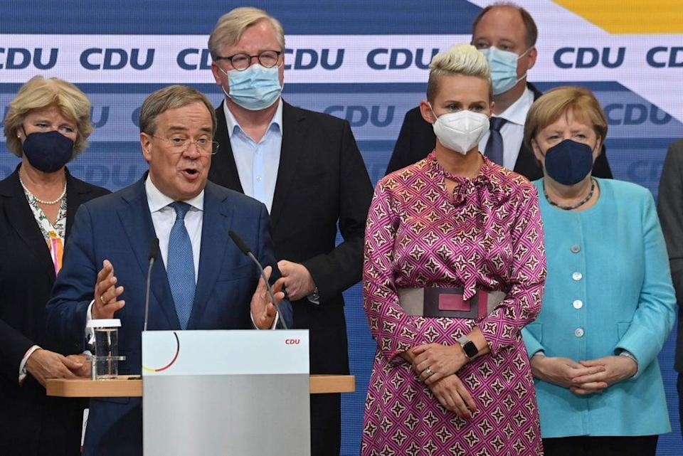 German Chancellor Angela Merkel on stage as CDU leader and Chancellor candidate Armin Laschet addresses an audience in Berlin  (AFP via Getty Images)