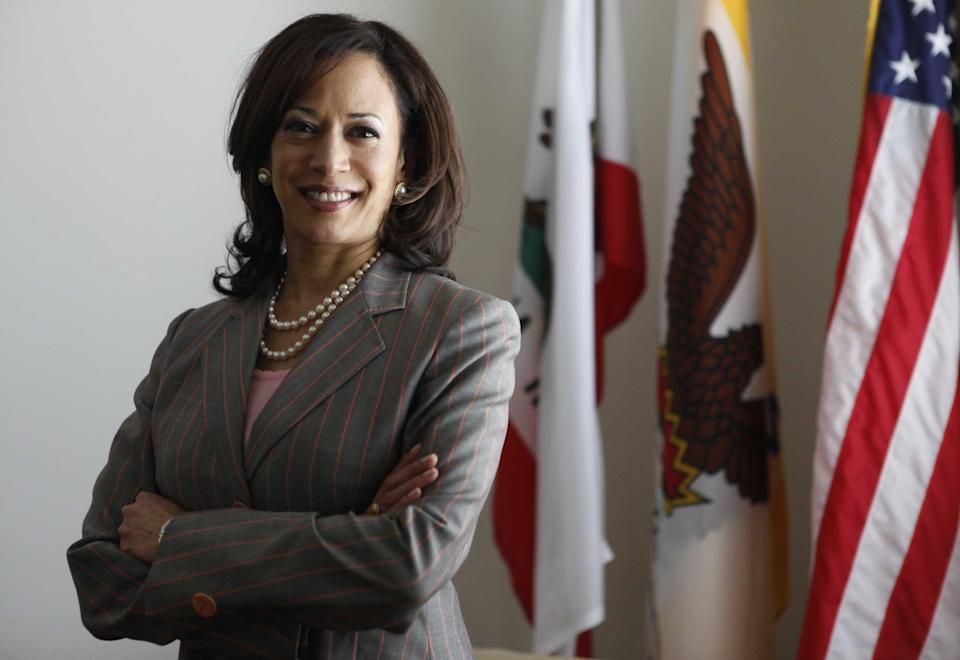 <p>Kamala stood for a portrait as District Attorney for San Francisco in April 2009, coordinating gold-rimmed pearl stud earrings with a double strand of pearls and a fresh pink pinstripe blazer.</p>