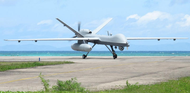 A MQ-9 Reaper with external fuel tank is seen operating out of a forward base in the region.