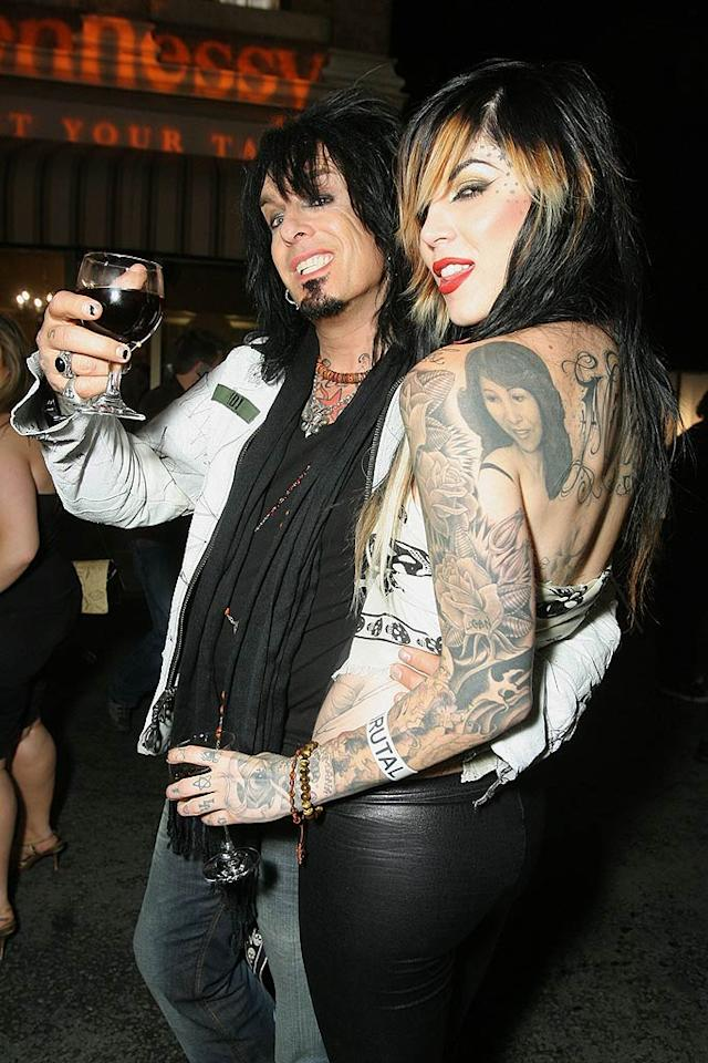 "Nikki Sixx (Motley Crue) and his latest lady love, tattooist to the stars Kat Von D, enjoy their red red wine. Alexandra Wyman/<a href=""http://www.wireimage.com"" target=""new"">WireImage.com</a> - May 21, 2008"