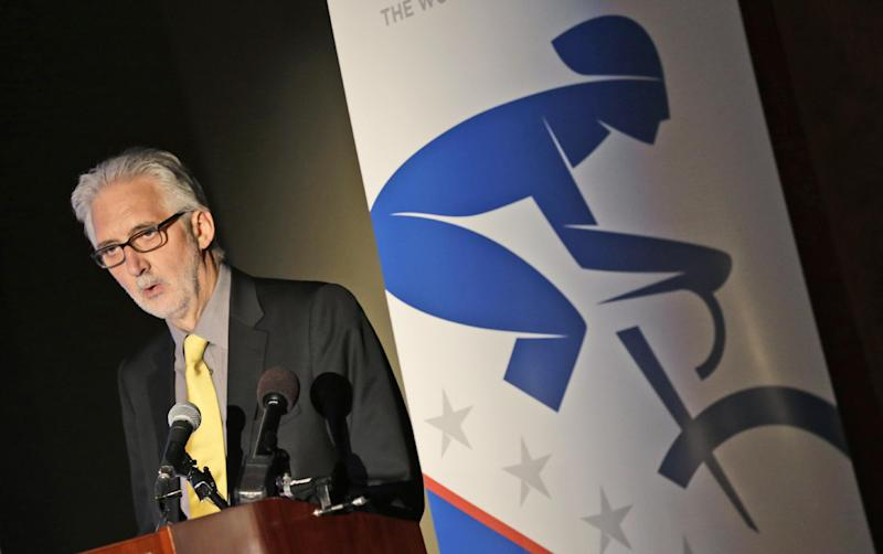 International Cycling Union President Brian Cookson gestures during a press conference announcing courses for the 2015 World Cycling Championships in Richmond, Va., Tuesday, Feb. 25, 2014.  The International World Cycling championships will be held in Richmond over nine days in September 2015